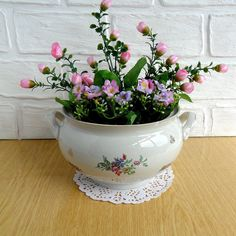 This is a pretty soup tureen . Sadly, it's missing the lid and ladle. You could still use it for its intended use or make it into a planter or floral arrangement. There is a chip on the lip of the tureen.