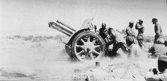 """Calculation of the Italian 75-mm cannon (Canone da 75/27 modello 06) is firing on British positions near the fort """"Ridotto Capuzzo» (Ridotta Kapuzzo) in Libya"""