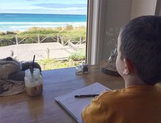 A milkshake and a view at @simonswaterfront. The perfect place for a budding artist on a Sunday morning. #destinationwarrnambool #simonswaterfront by chrisallsopphotography