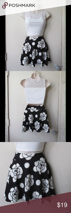 Impressive Black Skater Skirt W/White Roses & Dots NWOT. This skirt is really cute and adorable. Soft and comfy. Stretchy material. Gorgeous colors and exclusive design. Size Small 6 - Negotiable Price. Skirts Circle & Skater