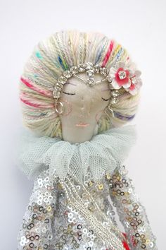 Bespoke Doll maker and Fashion designer living and working in Somerset.