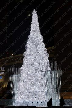 The most beautiful Christmas tree this year, people say, is the crystal tree that stands in the center of Beijing at the entrance to the twin LG Towers