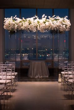 Glasshouses wedding, photographed by Mikkel Paige, Brilliant Event Planning. Luxe wedding, flower wall, flower garlands, lucite chuppah, orchid chuppah, NYC Wedding