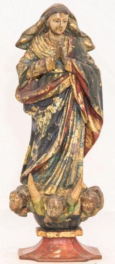 Imagem de Nossa Senhora da Conceição, madeira policromada. Bahia, século XIX. Alt. 30cm. Vendida pelo preço base 600,00.