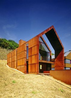 Modern cor-ten steel and glass house design with unique facade in luxembourg