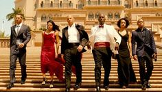 Getting the gang together: The late Paul Walker, pictured left, was part of a starry cast that includes Michelle Rodriguez, Vin Diesel, Jordana Brewster, Tyrese Gibson and Dwayne Johnson (not shown)