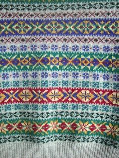 Fair Isle pattern from a great hand-knit sweater creator who actually lives on Shetland Island. Incredibly reasonable prices, too, for them. Look at those colours! Fair Isle Knitting Patterns, Knitting Charts, Knitting Stitches, Knit Patterns, Free Knitting, Stitch Patterns, Handgestrickte Pullover, Fair Isle Chart, Fair Isles