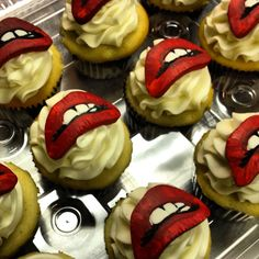 Rocky Horror Picture Show themed cupcakes. Lips hand cut and painted individually and made out of sugar. @City Cakes  www.citycakesny.com www.facebook.com/citycakes