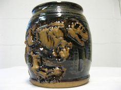 Dinosaur pot.... very cool glaze and dinosaur