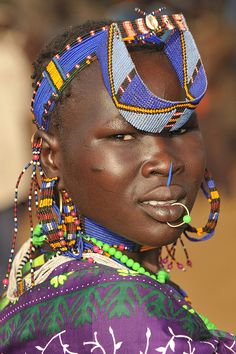 Africa |  Jie girl.  The Jie people live also in southern Sudan, a bit more to the West than the Toposa, with whom they compete for grazing grounds and women.  Photo credit Geert Henau