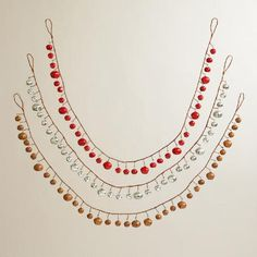 In matte red, silver and copper, each strand includes 35 bells hanging from adjustable paper-wrapped wire that add a cheery jingle to your holiday decor.
