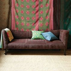 kilim sofa         • Solid mango wood frame with cotton kilim upholstery; solid wood legs with black finish.    • A Limited Edition item, a rare and unusual piece sourced from around the wo...