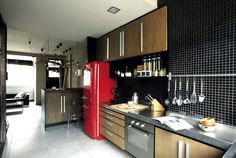 The bright red Smeg fridge is the star of this kitchen. It lends a vintage vibe to this sleek modern kitchen. Kitchen Sink Diy, Kitchen Dining, Kitchen Decor, Kitchen Cabinets, Dining Rooms, Small Living Rooms, Home Living Room, Smeg Fridge, Kitchen Themes