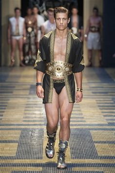 Meet Fashion's 'Magic Mikes': Feast Your Eyes on the Nearly Naked Models of Men's Fashion Week: The start of Versace's spring show was basically the beginning of a very fancy strip show. In Ancient Roman times.