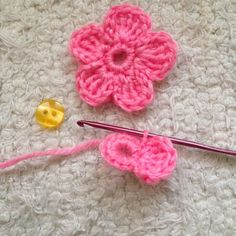 How to crochet a 5 petal flower via @Guidecentral - Visit www.guidecentr.al for more #DIY #tutorials