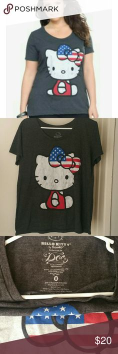 Torrid Hello Kitty American Flag Bow tshirt No longer sold in stores or available online anymore. Torrid Hello Kitty W.American Flag Bow ter. Dark grey tee with a a little bit if a distressed look on Hello Kitty as seen on torrid photo as well. Size 0X and worn once and was kind of big for a 0. Was washed and put away. NO TRADES.  PRICE FIRM torrid Tops Tees - Short Sleeve
