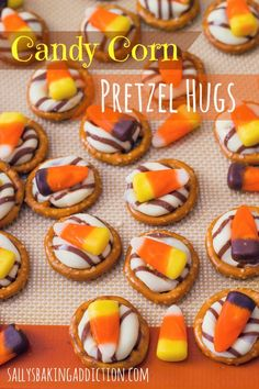 Candy Corn Pretzel Hugs - an easy Halloween treat! Place pretzels on a silicone or parchment lined baking sheet, top each with a hug. Put in oven for about 4 minutes. Pull out of oven and quickly place a candy corn on top of each hug. Halloween Goodies, Halloween Desserts, Halloween Cupcakes, Halloween Treats, Halloween Party, Halloween Pretzels, Happy Halloween, Halloween Havoc, Halloween Clothes