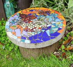 mosaic garden seating.   make your glass or mirror fragments safe by putting them in a bucket with a handful of sand and a couple of litres of  water. Swill it around for 30 seconds and all the sharp edges are made safe. You can also do the same with your broken tiles