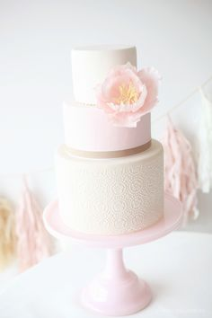 Simple & elegant cake| one large single bloom in pastel pink on a three tiered cake. Beautiful wedding or birthday cake or adapt for a Baptism/ Christening/ First Communion celebration