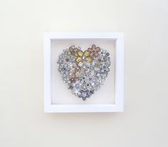 A framed picture of a painted heart shape, adorned with free hand machine embroidered flowers, which are all cut out by hand. The box frame measures x and deep and is painted white. Emma Lou, Free Motion Embroidery, Christening Gifts, Box Frames, Embroidered Flowers, Heart Shapes, Bloom, How To Make, Handmade