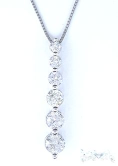 Cut: Round Cut  Carat: 1.7  Color: H-I  Clarity: SI2/I1  Grams: 2.5  Metal Purity: 14 Karat White Gold  Necklace Type: Diamond 2PC Drop Down Pendant Chain  Price: $1,650  100% Natural earth mined diamond I do not sell enhanced diamonds  Ships out in an elegant jewelry box for your pleasure