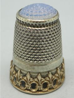Silver with blue glass on the top. Thimble-Dedal-Fingerhut.