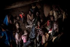 In the village of Buram, the women and children hide in a mountain cave while the bomber is flying above their village.  The bombers a...