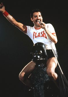 1980 - Freddie Mercury Sitting on Darth Vader's Shoulders while wearing a Flash Gordon shirt. Your Argument is Invalid.
