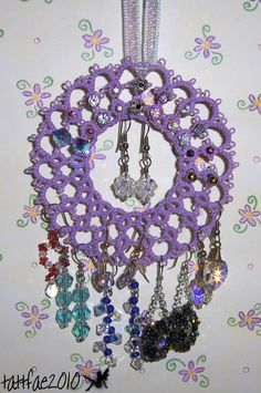 As it looks to me:  For the elegant lady's boudoir - tatted dream catcher!  ;)))))))