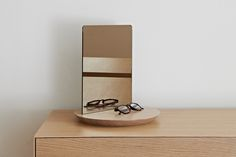 Designed by Theo Williams Studio Made from solid oak and veneer. Petrol blue oak - blue or grey mirror. Natural Oak - amber or clear mirror. Mirror can be displayed portrait or landscape. Solid Oak, Floating Nightstand, Photo Wall, Display, Canning, Table, Wall Photos, Mirrors, Design