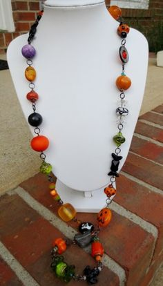 """34"""" Long - Whimsical Halloween Ghosts, Pumpkins, Candy OH MY! Necklace  Loaded with all sorts of goodies orange horn, yellow horn, crystals, shell, Czech glass,   ceramic Jack O Lantern, murano glass"""