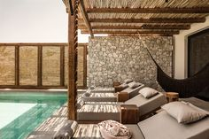 The rooms and suites at Casa Cook in Kos Greece offer a stylish and modern feel and great amenities. Outdoor Pool Furniture, Outdoor Decor, Villas, Surf, Casa Cook, Hotel Door, Beach Shack, Construction, Pool Designs