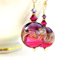 Pink Purple Gold Wave Earrings Beach Dangle Earrings Murano Earrings Ocean Earrings Wave Jewelry Nautical Earrings Beach Jewelry ocean earrings beach earrings lampwork earrings glass earrings wave earrings ocean jewelry beach jewelry nautical earrings gold filled earrings nautical jewelry purple pink gold fuchsia earrings Murano earrings 29.00 USD #goriani