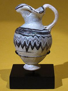 Rare Greek Core-Formed Glass Oinochoe. This and more ancient art for sale on the CuratorsEye.com
