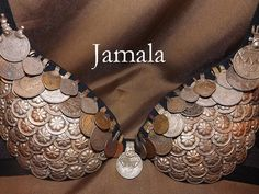 Coin Bra by NhazamaTribalDesigns - love the overlapping flower pieces and contrasting texture of coins. Could work well for a boobylicious bra as full coverage of coins looks too bulky. Hm..
