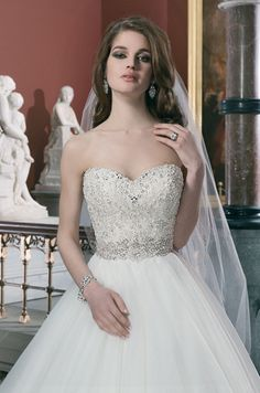 Tulle ball gown features intricately beaded bodice with a sweetheart neckline. Justin Alexander, 2014