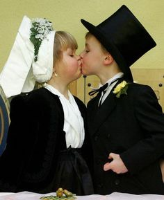 """Child """"groom"""" Maurice (R) kisses his """"bride"""" Lenka during a traditional Sorbian """"birds wedding"""", 25 January 2008 at a kindergarten in Cottbus, eastern Germany. Children of Sorbian origin traditionally celebrate the symbolic wedding to greet the upcoming end of the winter. The Sorbs are a small west Slavic people, living as a minority in the German states of Saxony and Brandenburg."""