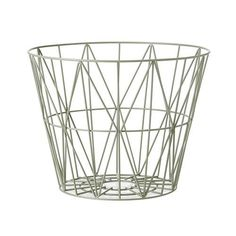 Wire Basket Dusty Green | Wire Basket is practical in its essence -a  great companion to firewood, blankets, cushions, yarn, magazines, toys, or laundry. Whichever way you decide to slice it, the Wire Basket is useful in every space and can even serve as a stool or side table if you flip it over.