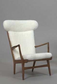Hans Wegner; Oak and Sheepskin Lounge Chair for Andreas Tuck, 1950.