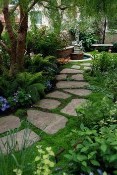 vorgarten gestalten gartenweg steinplatten pflanzen bäume