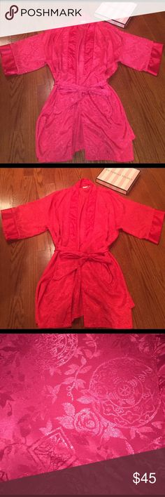 VICTORIA SECRET ROBE Gorgeous red with rose designed pattern silk robe. 100% polyester. Perfect condition. The inside little strings are cut but aren't noticeable if wearing.one size fits all Victoria's Secret Intimates & Sleepwear Robes