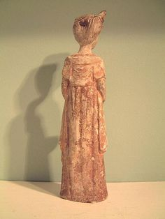 A Chinese painted pottery figure of a standing lady attendant, well modelled and with traces of original orange and dark red pigments. Sui or early Tang dynasty, 6th/7th century AD.
