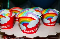 Colorful cupcakes at a Rainbow Birthday Party!  See more party ideas at CatchMyParty.com!