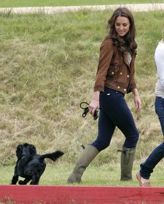 Kate Middleton was seen walking her dog Lupo with a friend in London's Hyde Park on 25 February 2013. The pregnant Duchess wrapped up from the bitter cold in her LK Bennett brown shearling Darwin jacket, trademark black skinny jeans and Le Chameau wellies. #wkw