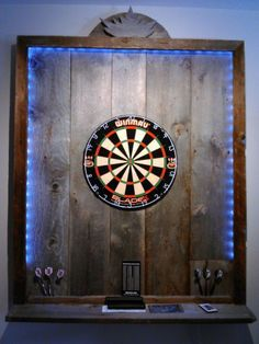 "wow your friends with this absolutely beautiful conversation piece. only one left. real barn wood dart board backboard, with built in led lighting and brand new winmau blade 4 dartboard included. the led lights are hidden behind the frame and the dartboard is ""sunk"" into the surrounding barnwood... the board was just built for christmas and is currently set up for vie"