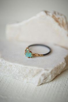 Artisan handcrafted Peruvian opal ring set on a recycled band made from oxidized sterling silver embedded with a mixture of 14-24K yellow rose and white gold. The claw and filigree setting is built to grip the stone and enhance the unique cut and vivid co