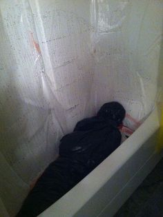Body bag in the bath! | 27 Disgustingly Awesome Ways To Take Halloween To The Next Level