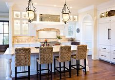 love this! tan backsplash with white cabinets!