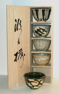 Japanese tea cups in miniature cabinet