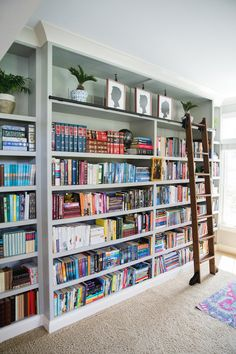 Love the bookshelves with the rolling library ladder. Love the bookshelves Floor To Ceiling Bookshelves, Library Bookshelves, Library Ladder, Library Wall, Dream Library, Living Room With Bookshelves, Diy Bookshelf Wall, Bookshelf Ladder, Creative Bookshelves